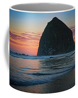 Coffee Mug featuring the photograph Sunset At Haystack Rock by Rick Berk