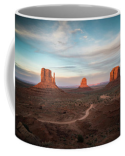 Coffee Mug featuring the photograph Sunset At Monument Valley by James Udall
