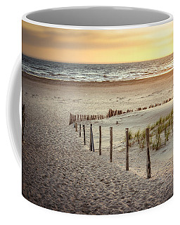 Coffee Mug featuring the photograph Sunset At The Beach by Hannes Cmarits