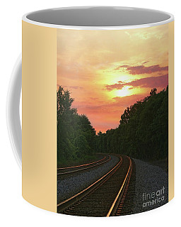 Coffee Mug featuring the photograph Sunset Lighting Up The Rails by Benanne Stiens