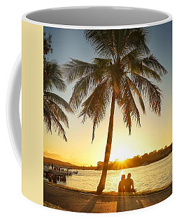 Coffee Mug featuring the photograph Sunset Lovers Under Palm Tree And Down By The River by Keiran Lusk
