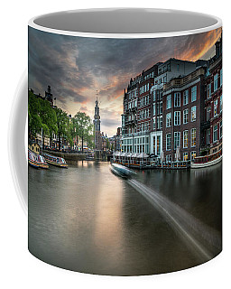 Coffee Mug featuring the photograph Sunset On The Amstel River In Amsterdam by James Udall