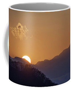 Coffee Mug featuring the photograph Sunset Over Asia  by Rikk Flohr