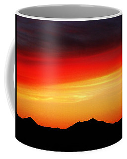 Coffee Mug featuring the photograph Sunset Over Santa Fe Mountains by Joseph Frank Baraba