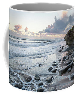 Sunset View In The Distance With Large Rocks On The Beach Coffee Mug