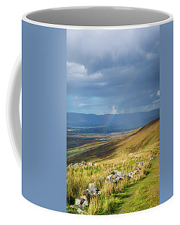 Coffee Mug featuring the photograph Sunshine And Raining Down With Rainbow On The Countryside In Ire by Semmick Photo