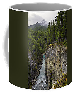 Coffee Mug featuring the photograph Sunwapta Falls Canyon by John Gilbert
