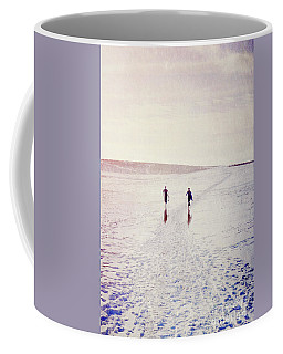 Coffee Mug featuring the photograph Surfers In The Snow by Lyn Randle