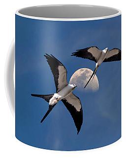 Swallow Tail Kites In Flight Under Moon Coffee Mug by Justin Kelefas