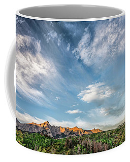 Coffee Mug featuring the photograph Sweeping Clouds by Jon Glaser