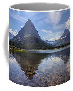 Coffee Mug featuring the photograph Swiftcurrent Lake And Mount Grinnell by Spencer Baugh