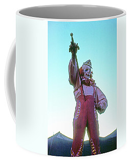 Coffee Mug featuring the photograph Sword Swallower by Laurie Stewart