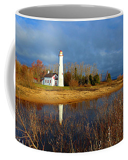 Coffee Mug featuring the photograph Tawas Lighthouse by Michael Rucker