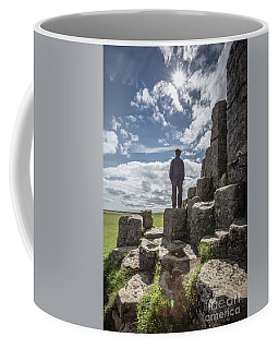 Coffee Mug featuring the photograph Teen Boy Standing On Basalt Rocks by Edward Fielding