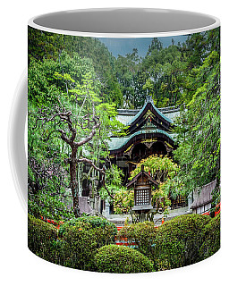 Coffee Mug featuring the photograph Temple In The Rain by Rikk Flohr