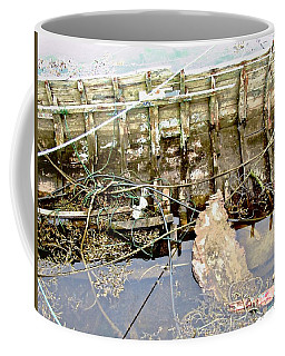 Coffee Mug featuring the photograph That Sinking Feeling by Stephanie Moore