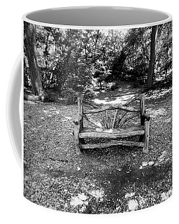 Coffee Mug featuring the photograph That Weird Bench One by Robbie Masso