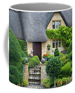 Coffee Mug featuring the photograph Thatch Roof Cottage Home by Brian Jannsen