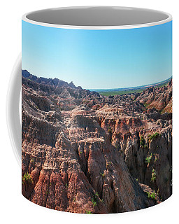 Coffee Mug featuring the photograph The Badlands by Sharon Seaward