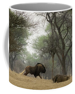 The Black Wildebeest Coffee Mug by Ernie Echols