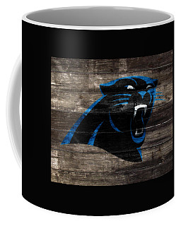 Coffee Mug featuring the mixed media The Carolina Panthers W8 by Brian Reaves
