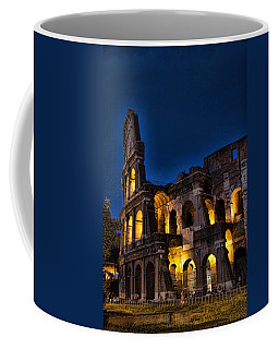 The Coleseum In Rome At Night Coffee Mug by David Smith