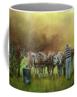Coffee Mug featuring the photograph The Cow Whisperer by Wallaroo Images