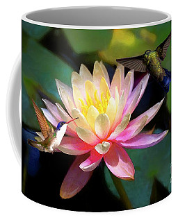 Coffee Mug featuring the photograph The Grutas Water Lillie With Hummingbirds by John Kolenberg