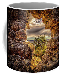 Coffee Mug featuring the photograph The Hole In The Wall by Chris Cousins