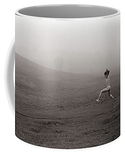 Coffee Mug featuring the photograph The Leap by Wayne King