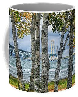 The Mackinaw Bridge By The Straits Of Mackinac In Autumn With Birch Trees Coffee Mug