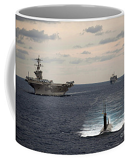 Coffee Mug featuring the painting The Nimitz-class Aircraft Carrier Uss Carl Vinson And A Submarine by Celestial Images