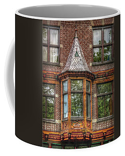 Coffee Mug featuring the photograph The Oriel by Hanny Heim