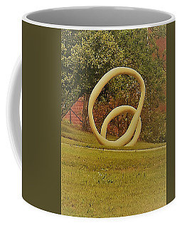 Coffee Mug featuring the photograph the rings of Mactown by Aaron Martens