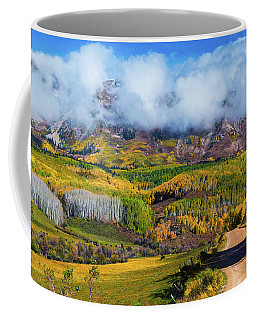 Coffee Mug featuring the photograph The Road To The Elk Mountains by John De Bord