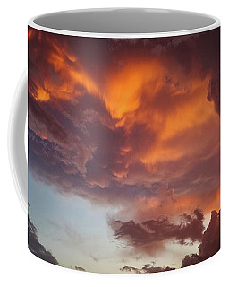 Coffee Mug featuring the photograph The Storm Blower by Ken Stanback
