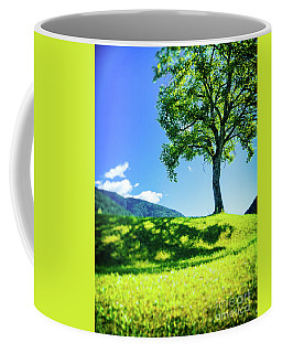 Coffee Mug featuring the photograph The Tree On The Hill by Silvia Ganora