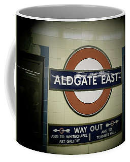 Coffee Mug featuring the photograph The Tube Aldgate East by Christin Brodie