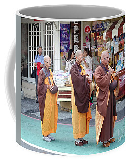 Coffee Mug featuring the photograph Three Buddhist Monks Chant Scriptures by Yali Shi