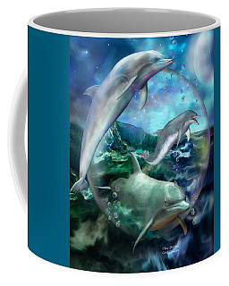 Three Dolphins Coffee Mug by Carol Cavalaris