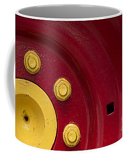 Three Yellow Nuts On A Red Wheel Coffee Mug