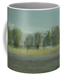 Coffee Mug featuring the photograph Through The Rain by DeeLon Merritt