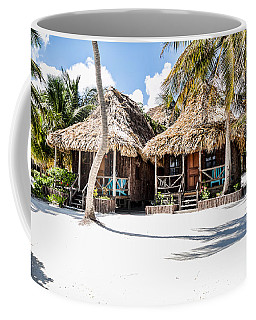 Coffee Mug featuring the photograph Tiki Huts by Lawrence Burry