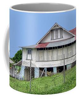 Tobago House Coffee Mug by Nadia Sanowar