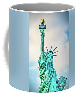 Coffee Mug featuring the photograph Torch Of Liberty by Nick Zelinsky