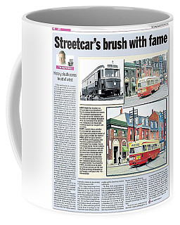 Coffee Mug featuring the painting Toronto Sun Article Streetcars Brush With Fame by Kenneth M Kirsch
