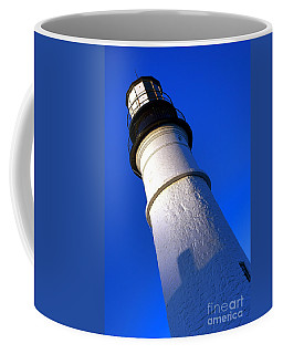 Coffee Mug featuring the photograph Towering Portland Head Light by Olivier Le Queinec