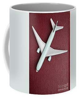 Coffee Mug featuring the photograph Toy Airplane Over Red Book Cover by Edward Fielding