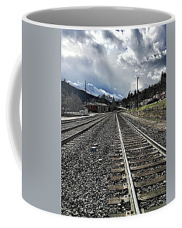 Coffee Mug featuring the photograph Tracks by JoAnn Lense