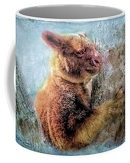 Coffee Mug featuring the photograph Tree Kangaroo by Wallaroo Images